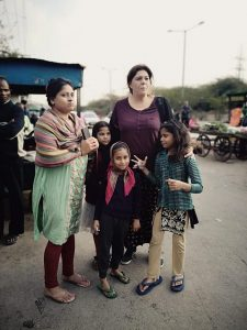 Daphne with children heading for the local market